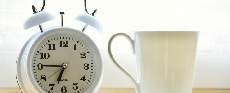 alarm clock and a cup