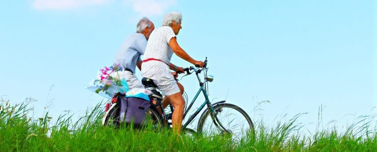 old man and a woman on bikes