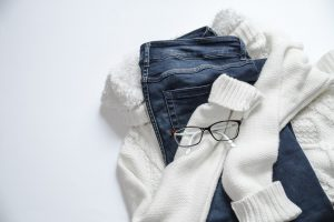 A white jumper, keys and glasses - prepare an outfit change when you're packing an essentials box