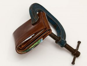 a wallet in a clamp