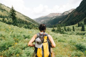 A woman hiking after moving to Highlands Ranchh