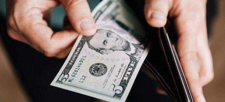 wallet, five dollar bill