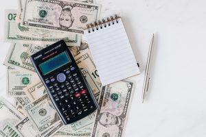 Calculator money paper and pen