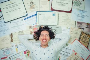 A person lying on certificates