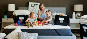 A mom packing with her children before moving
