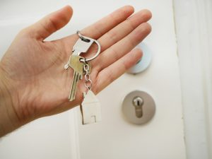 person holding keys in hand