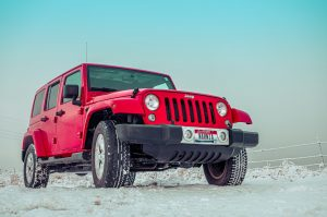 red jeep on snow