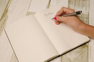 a person writing a plan