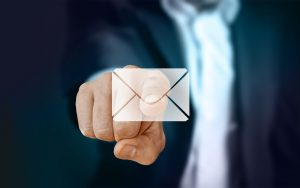 hand pointing at email