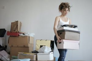 girl carrying boxes