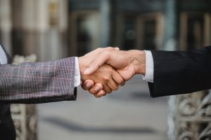 two persons handshaking