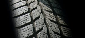 A picture of a black tire up close.