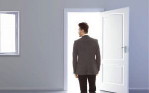 man standing in front of door and thinking about common mistakes people make when moving